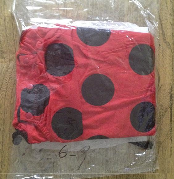 Romper suit in packaging